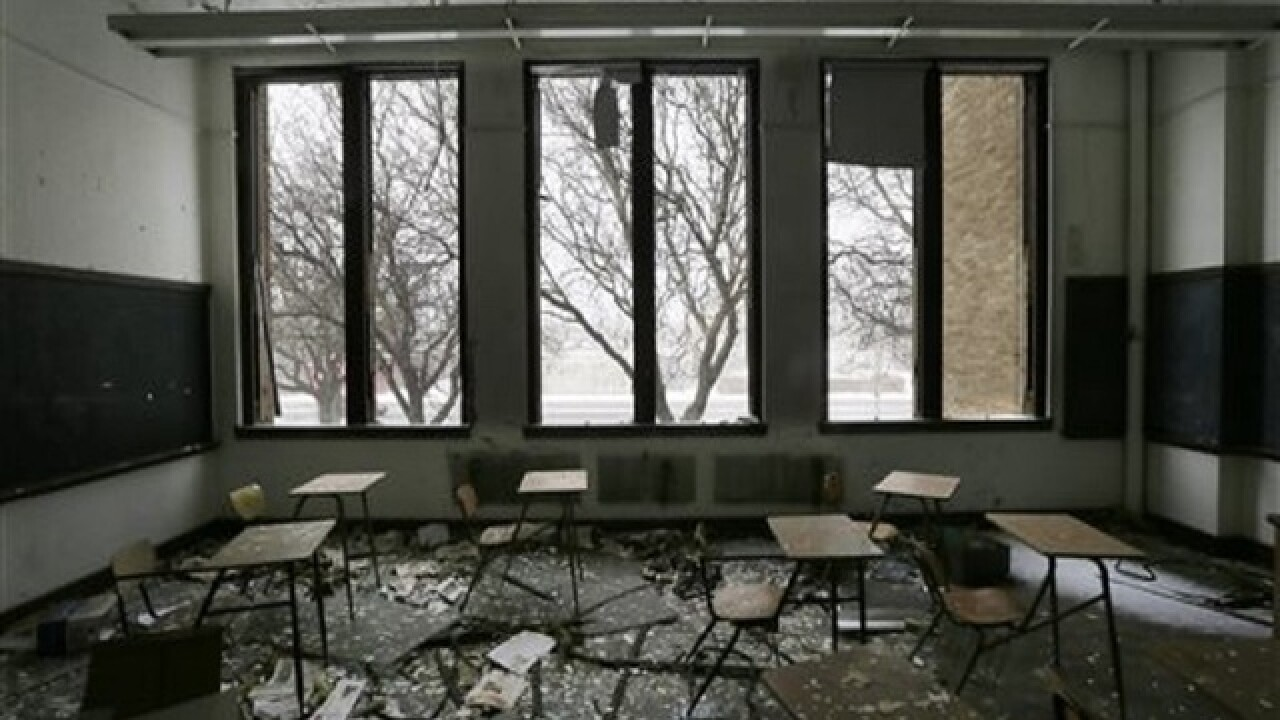 Michigan governor signs $617 million Detroit schools bailout