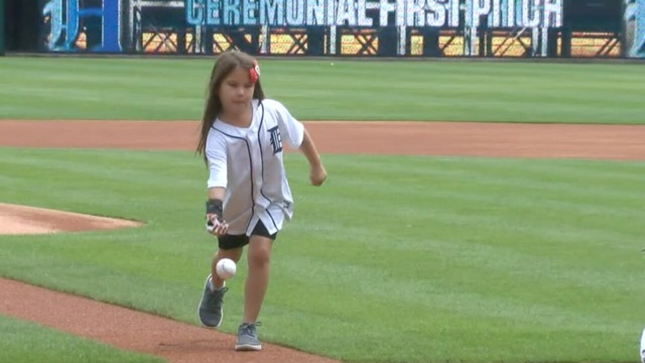 Hailey Dawson uses Tigers prosthetic hand to throw out 16th MLB first pitch