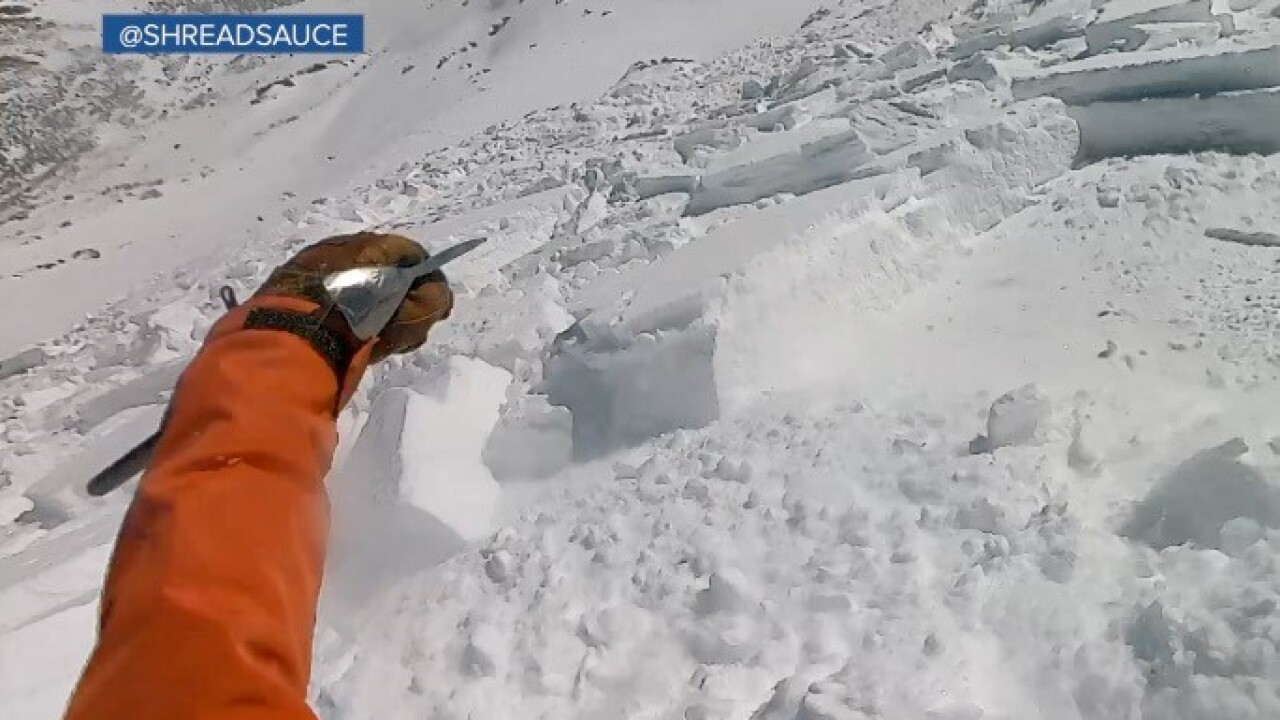 A snowboarder was caught in an avalanche.