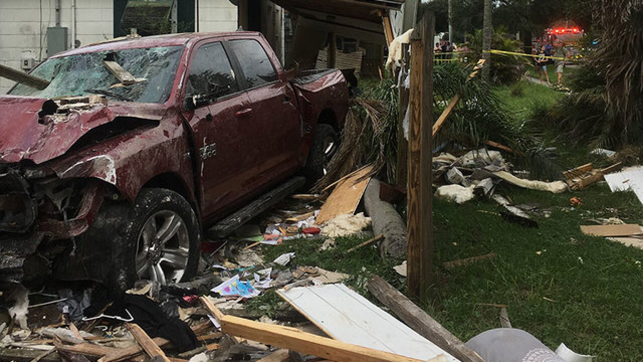 Truck drives into St. Pete home, injuring woman