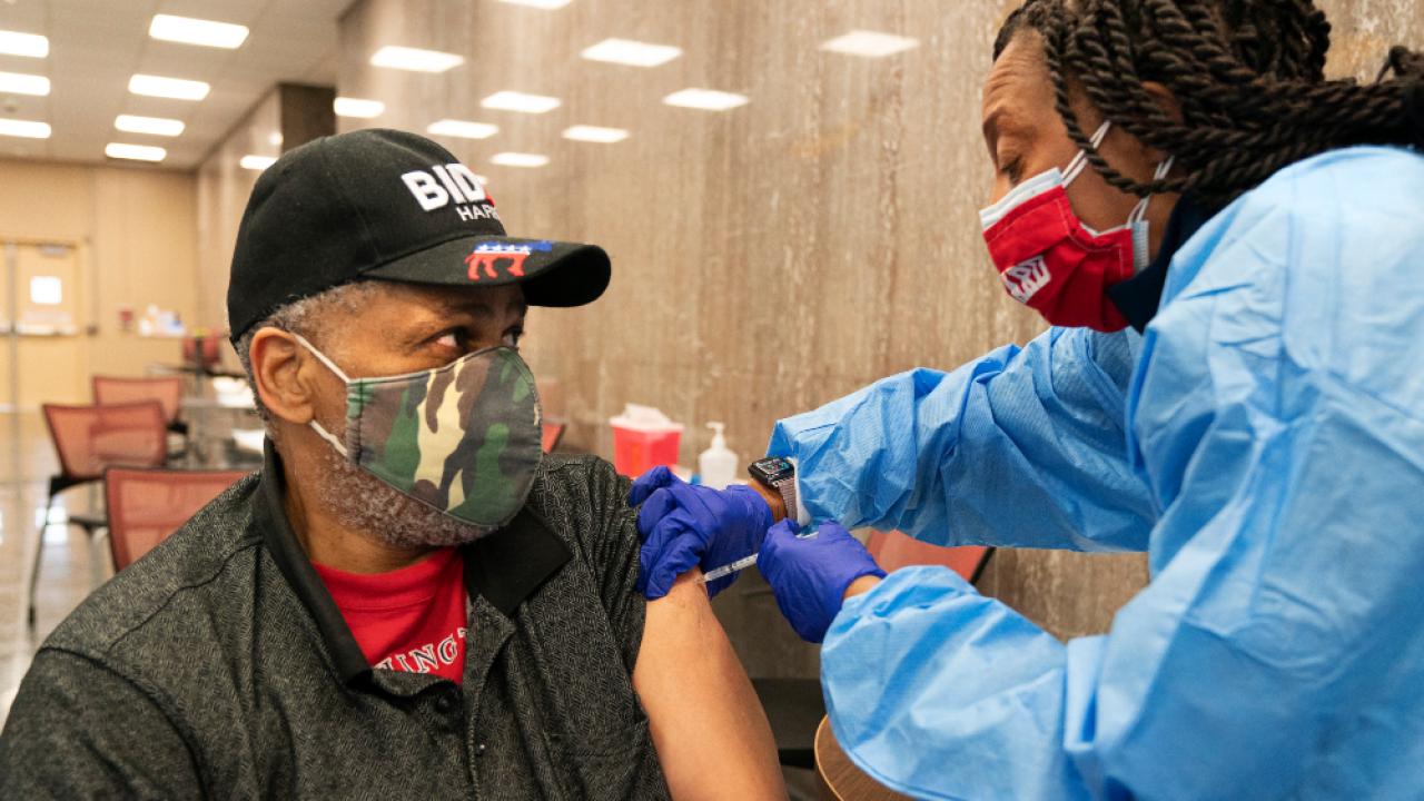 Black-man-getting-COVID-19-vaccine.png