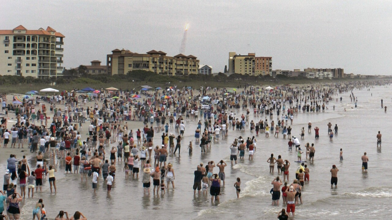 Spectators gather on Cocoa Beach to watch launch of space shuttle Atlantis in 2011
