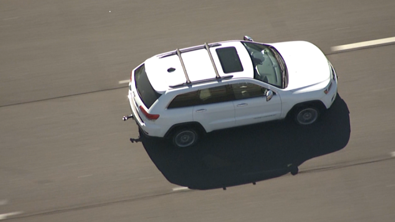 Authorities say a fugitive wanted by the U.S. Marshals Service has been taken into custody after a nearly 50-mile freeway chase.
