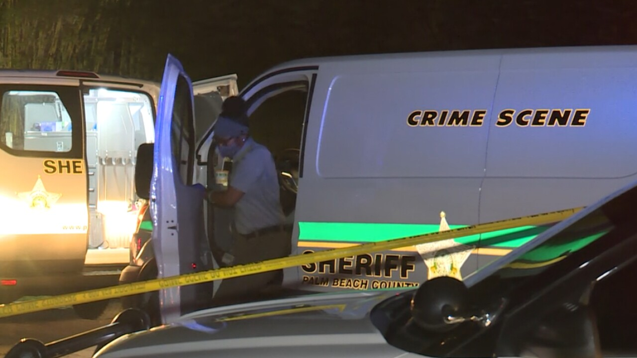 The Palm Beach County Sheriff's Office investigates a deadly shooting in the 15000 block of 98th Trail North in Jupiter Farms on June 22, 2021.jpg