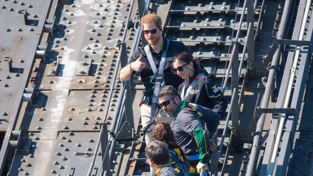 Prince Harry opens annual Invictus Games by climbing bridge