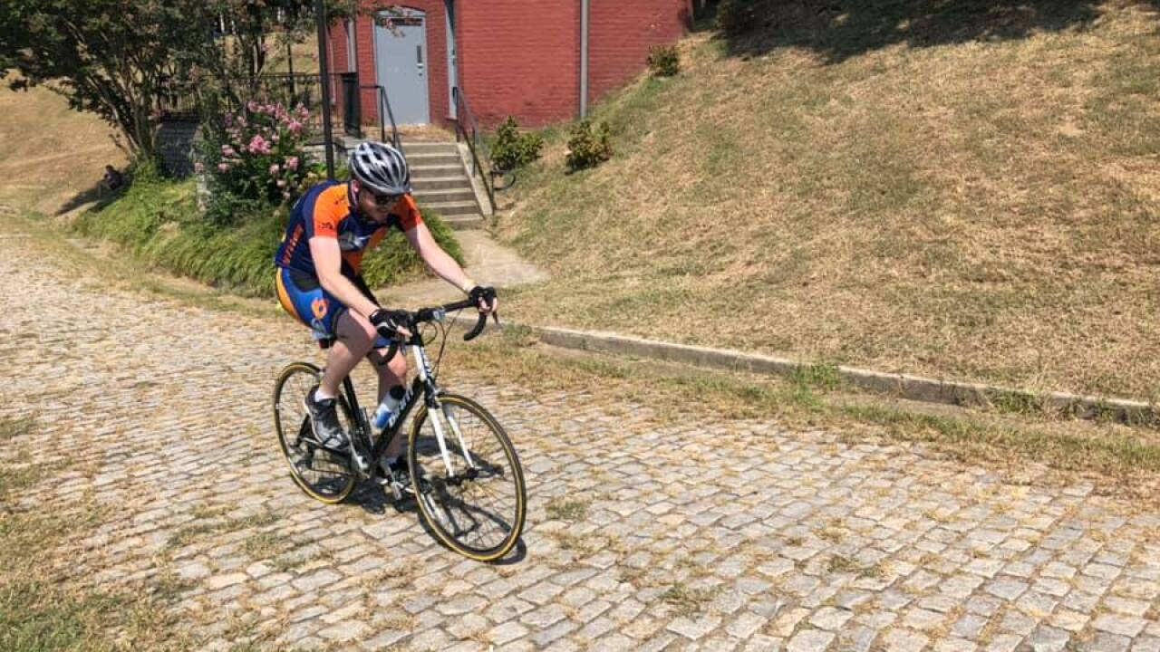 Cyclists tackle Libby Hill in quest to conquercancer