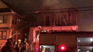 Buffalo fire crews battle large house fire on Weyand Avenue Friday morning.