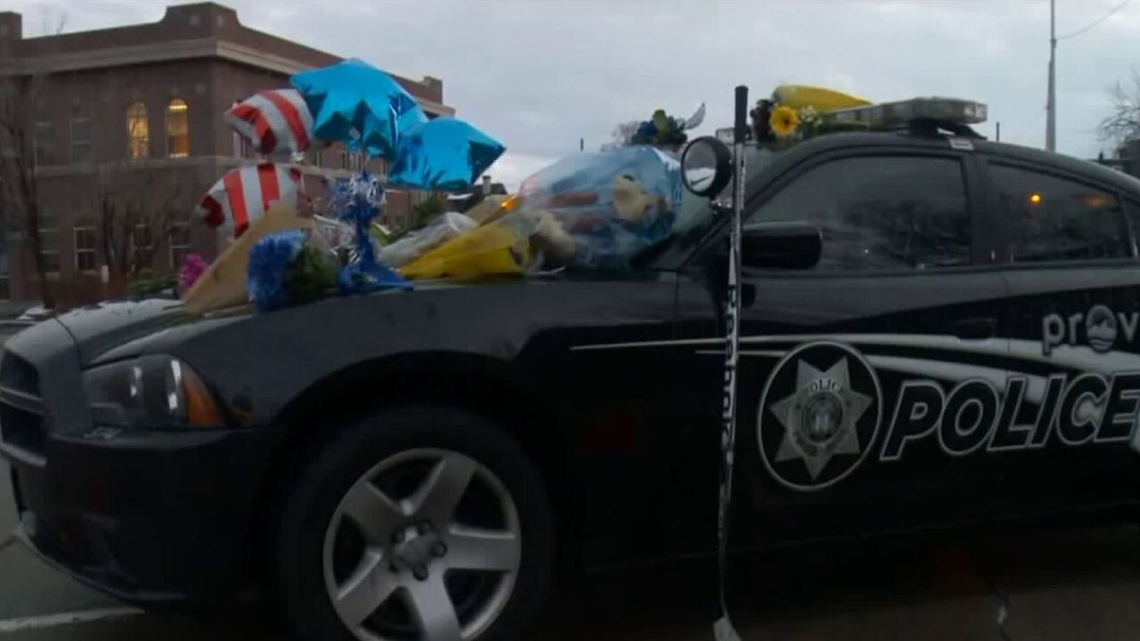 Utah community pays respects, creates shrine on fallen officer's squadcar