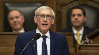 Evers to raise age for charging juveniles, delay closure