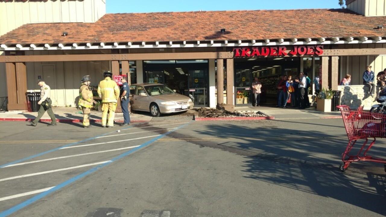 At least three injured after car strikes Trader