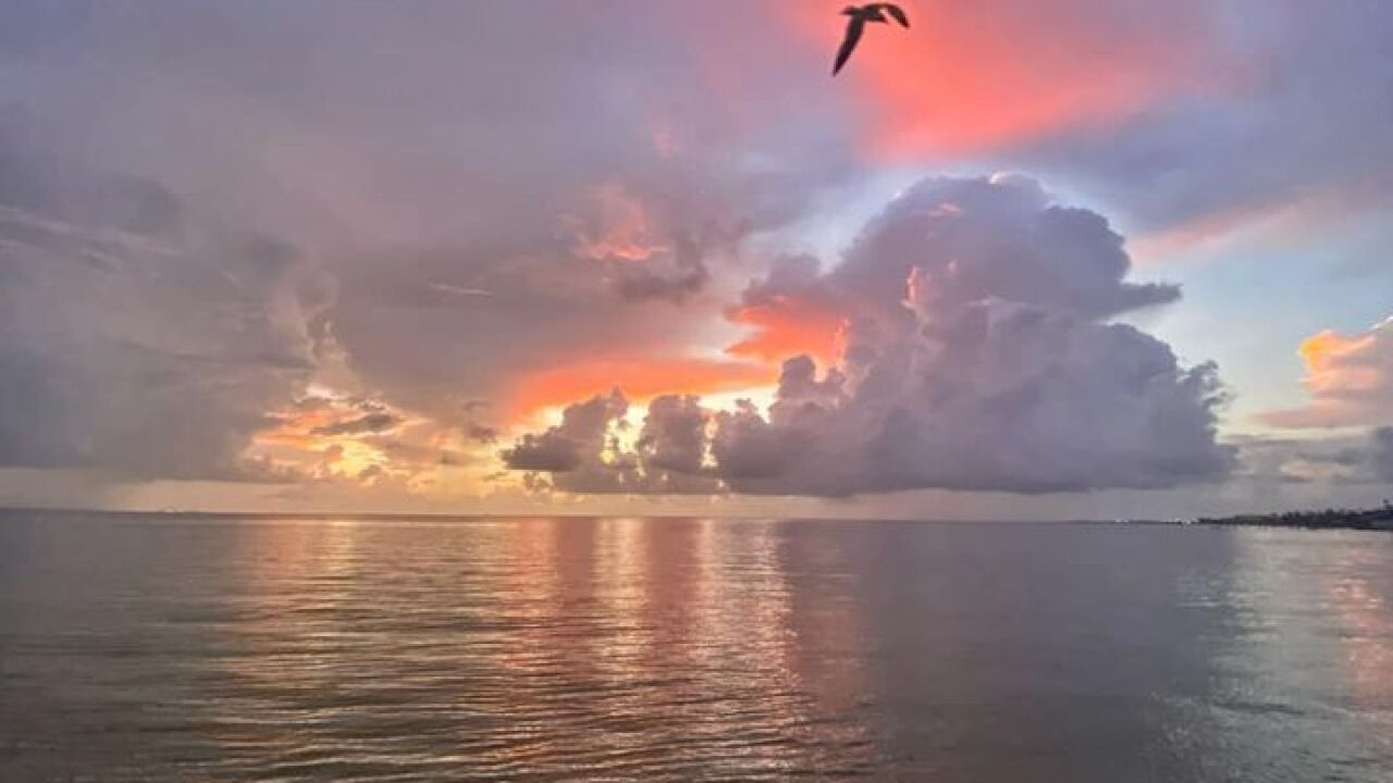 Morning shower/storms in the Gulf - Photo By: FB Weather Watcher Lu Ann Kingsbury