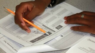 Report: SAT to assign score to reflect social, economicbackground