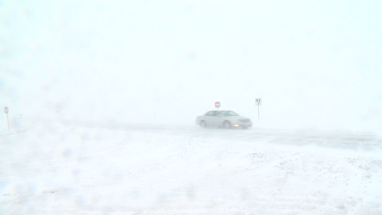 blizzard-car-on-highway.png