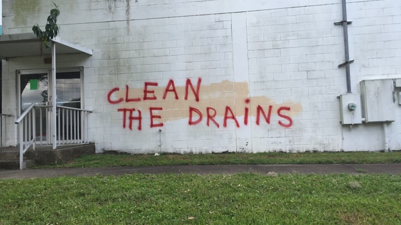 Neighbor: Church swamps yard, so I vandalized