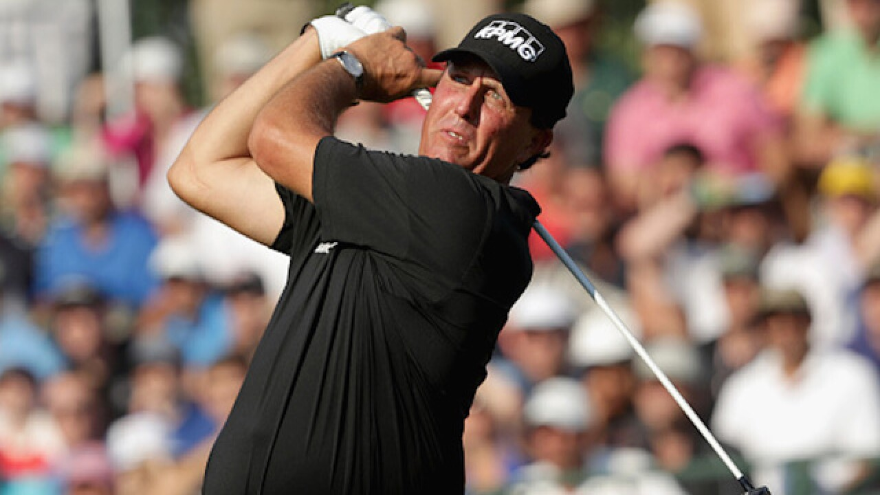 Video: Phil Mickelson hits shot onto road