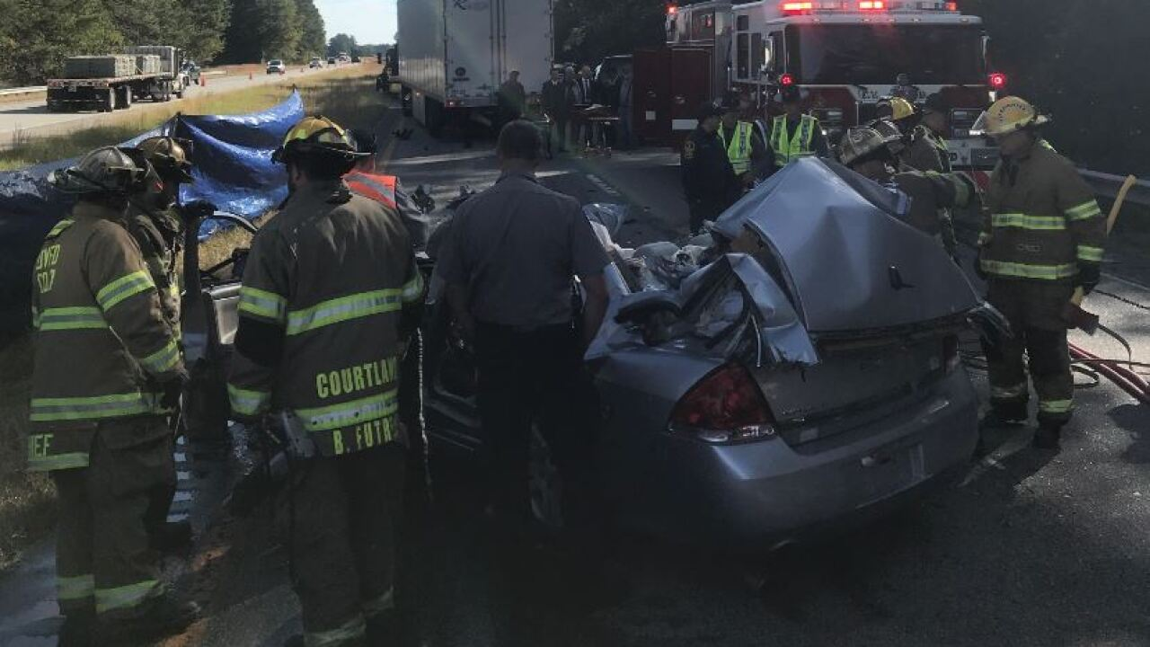 Four people die after car rear ends stopped tractor trailer in Southampton Co.