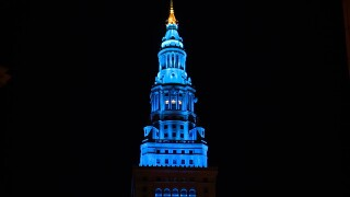 The Terminal Tower lights up blue.