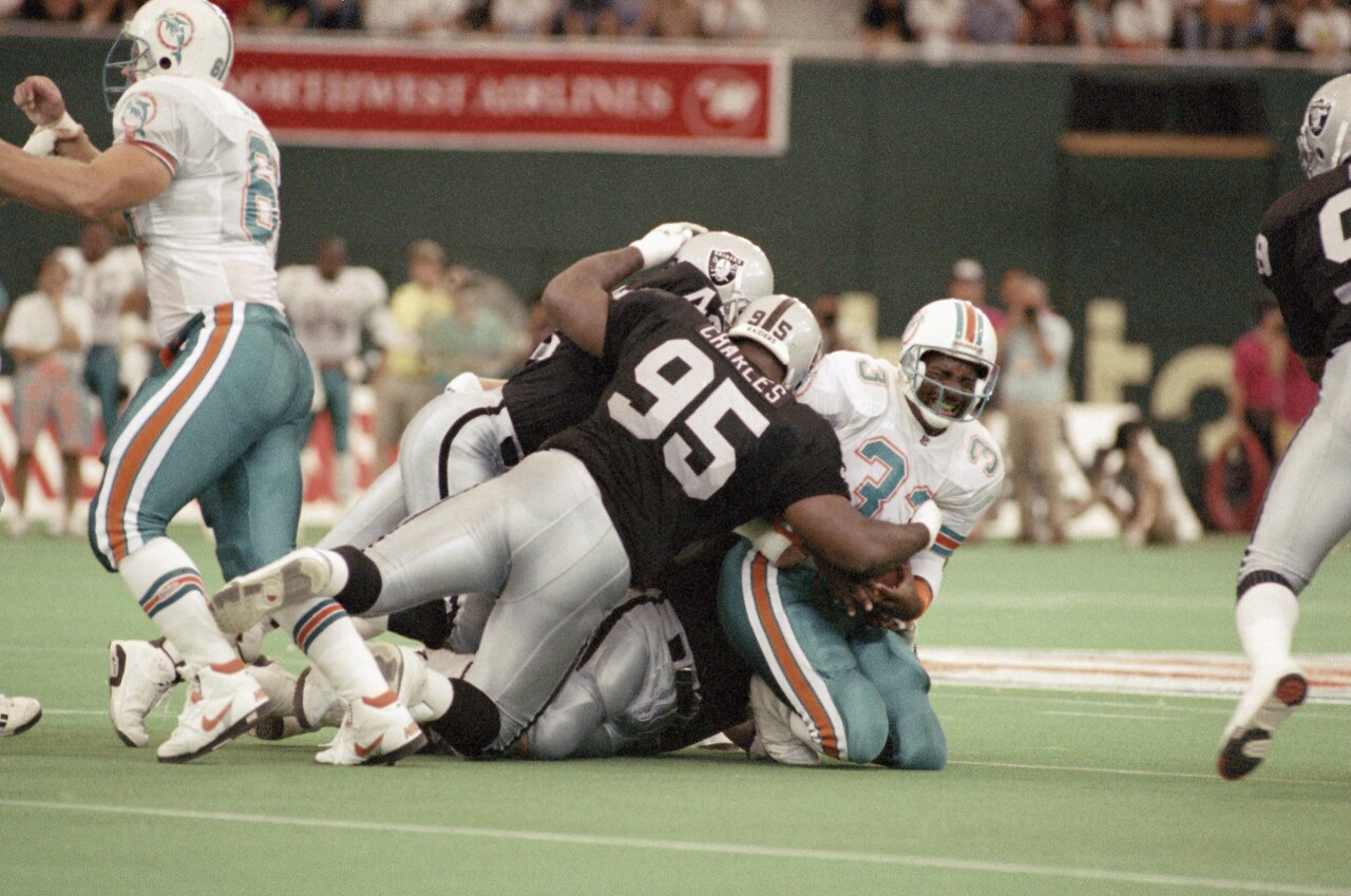 Miami Dolphins running back Sammie Smith tackled in 1991 American Bowl