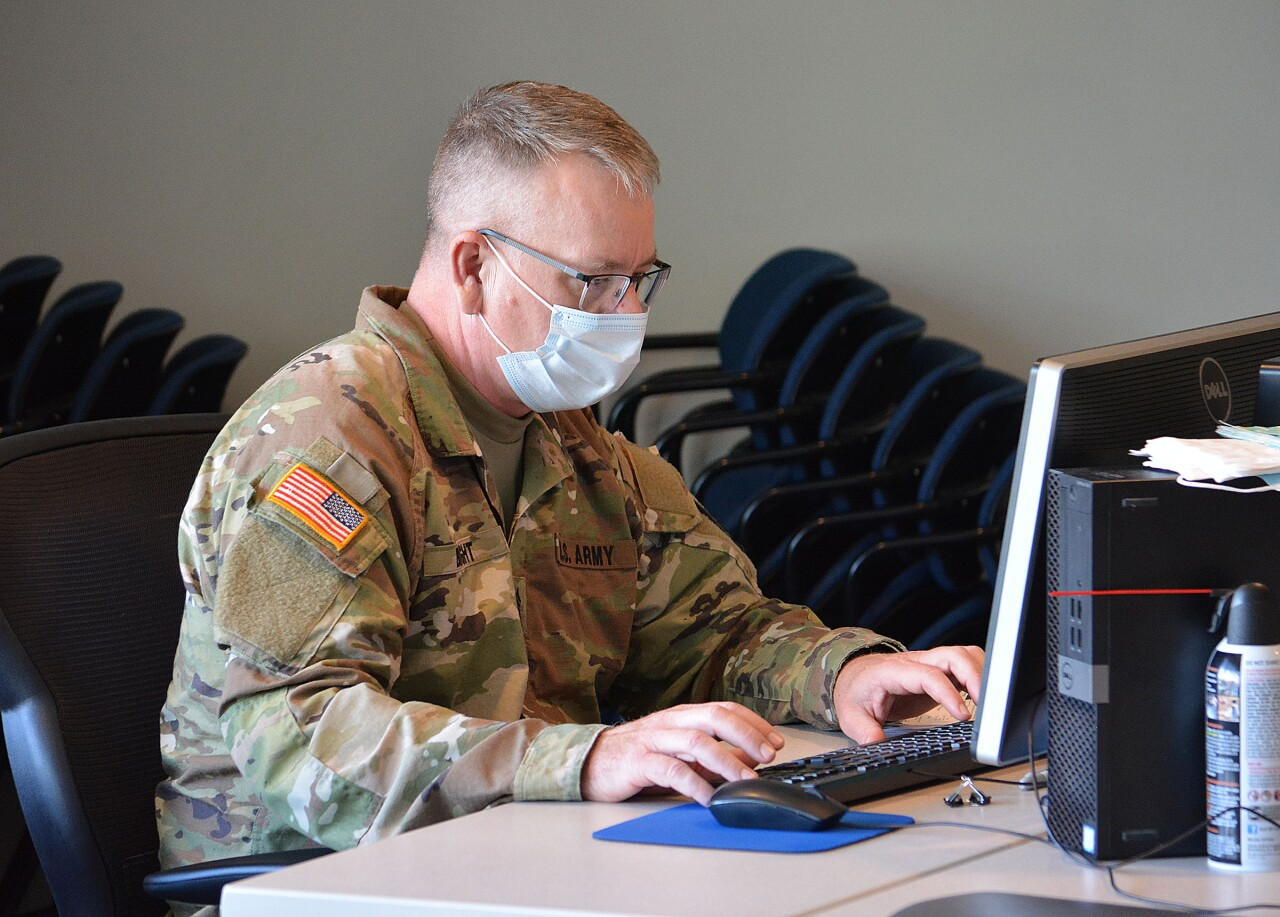 SFC Don Bright helping enter COVID-19 sample data into the computer