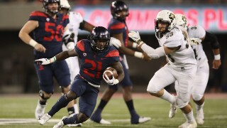 Tate's 5 TD passes lead Arizona to 42-34 win over Colorado