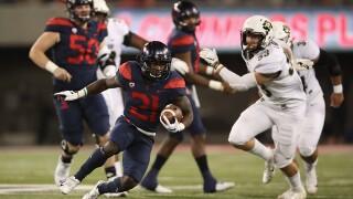 Tate's 5 TD passes lead Arizona to 42-34 win over Colorado