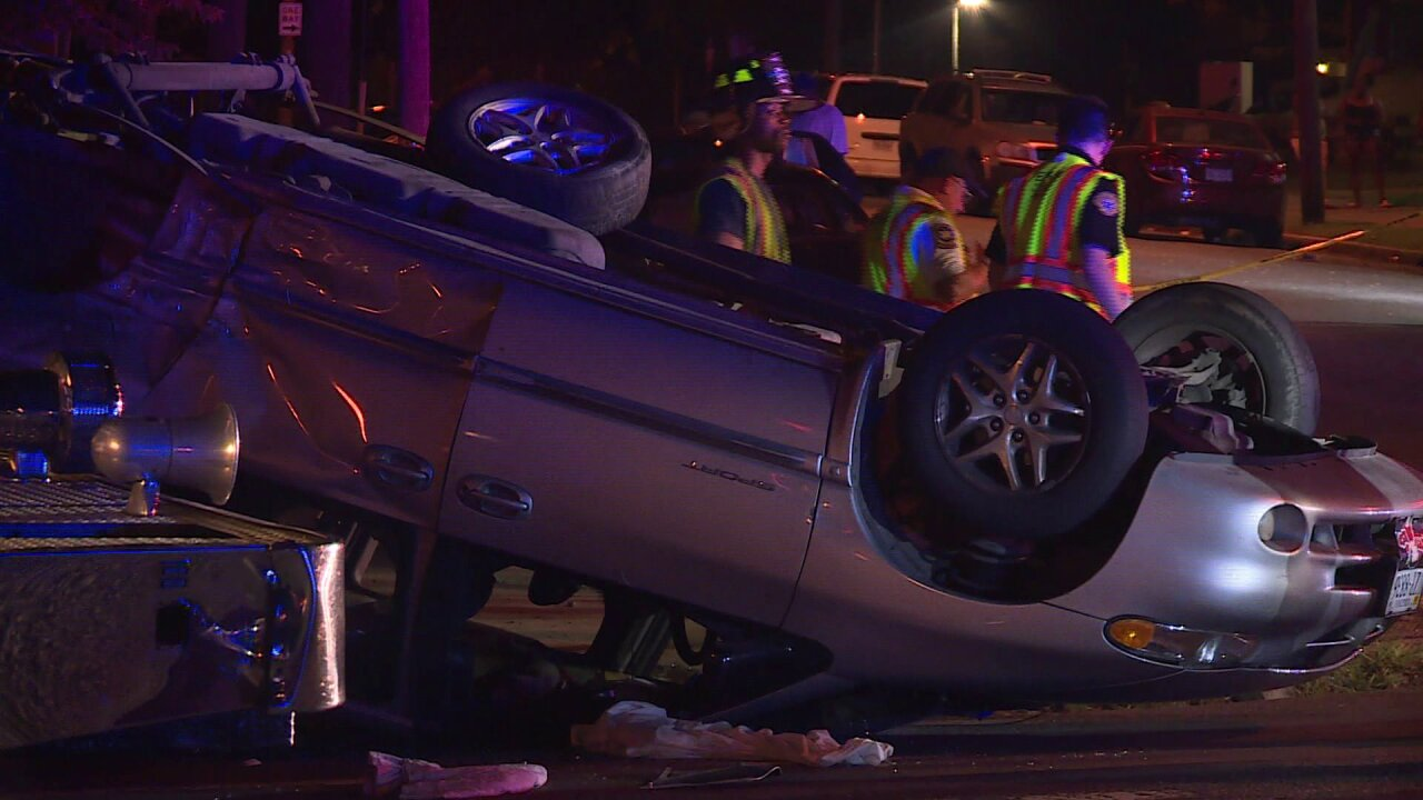 Car overturns after collision with Richmond Policecruiser