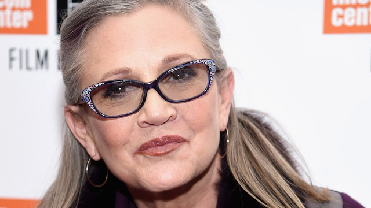 'Star Wars' star Carrie Fisher suffers 'massive heart attack' on flight, report says