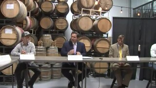 Gov. Ron DeSantis sits with brewery owners in St. Petersburg, Sept. 3, 2020