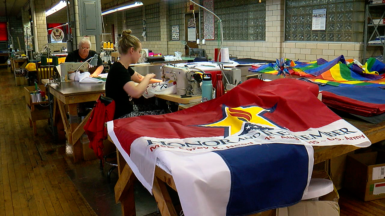 Honor and Remember flag being sewn.png