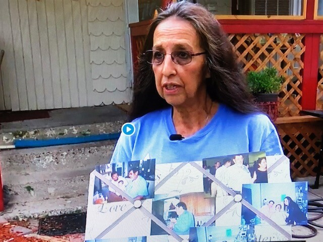 Rose Gallegos Holds photos of her late father