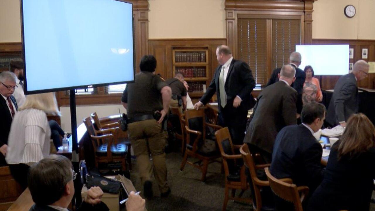 Trail slashes neck in court.JPG