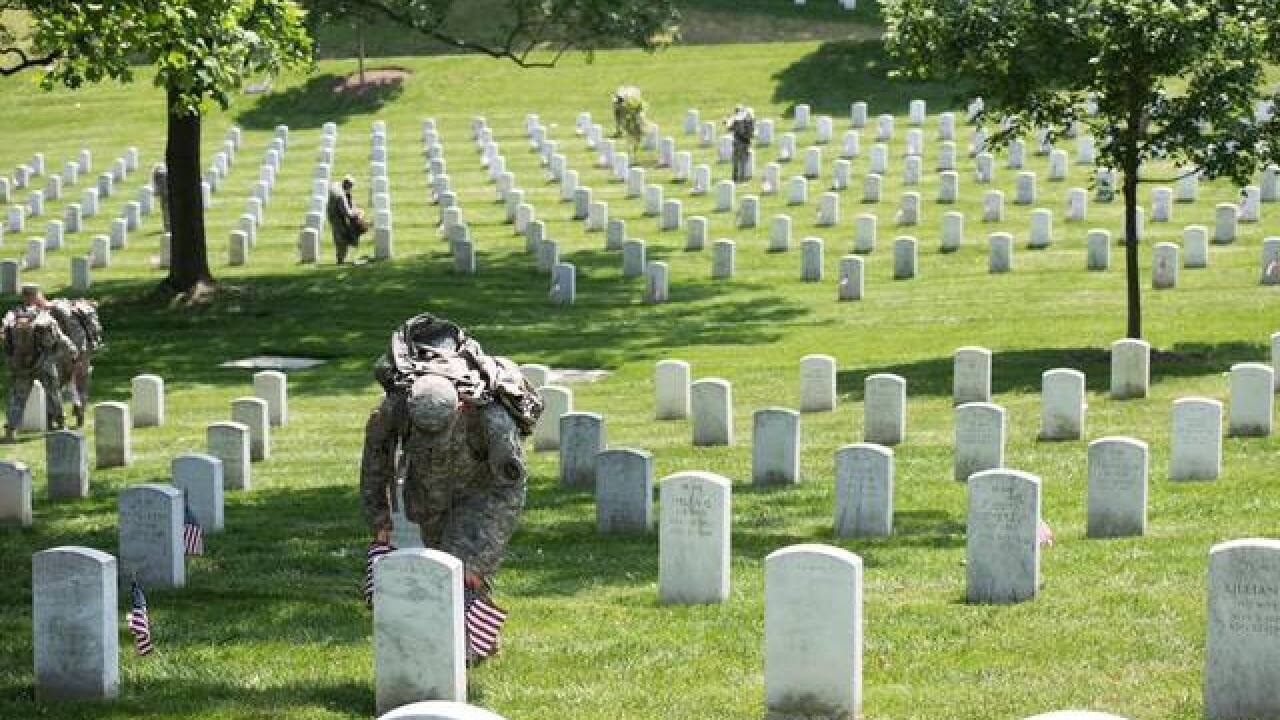 PHOTOS: Soldiers place flags at Arlington
