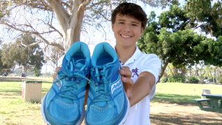 Owen Arnaudy collecting used shoes.png