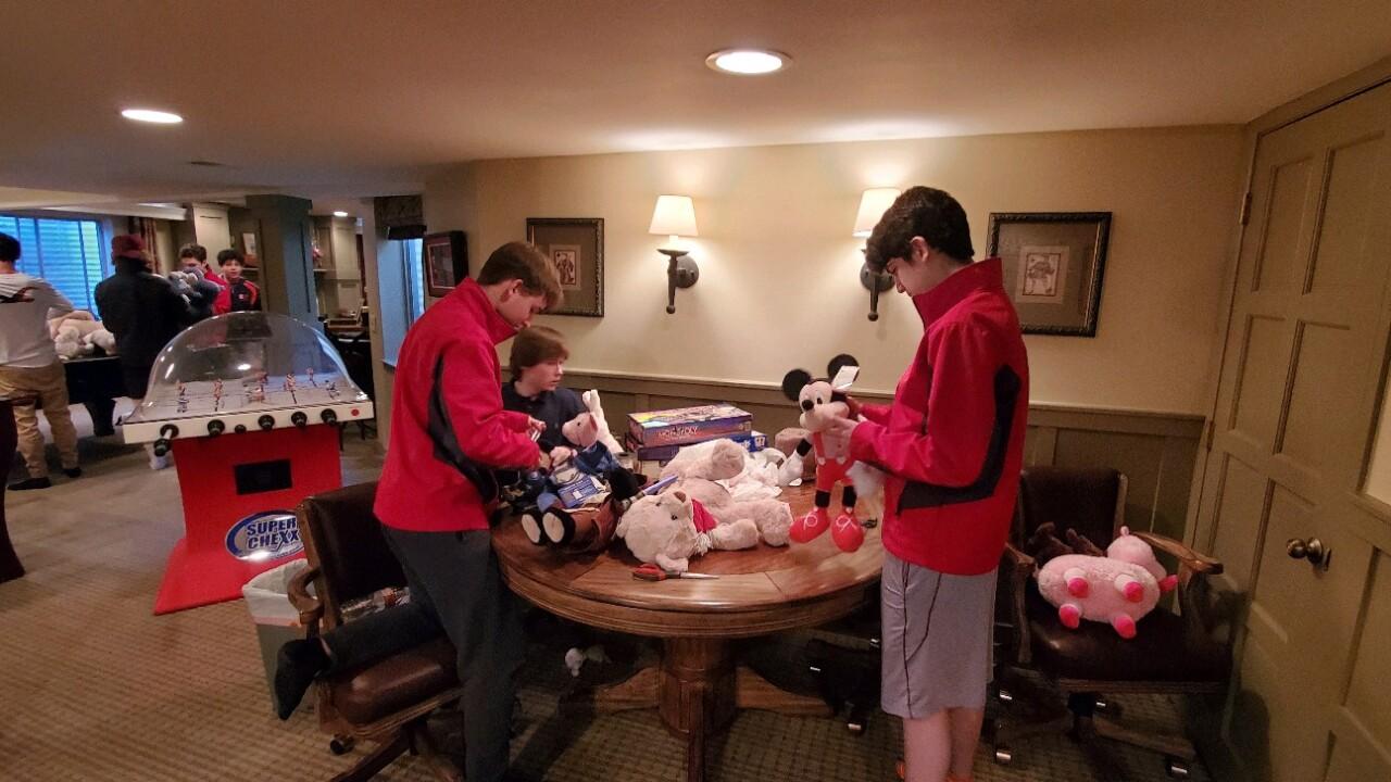 Regis Jesuit hockey - kids teddy bears.jpg