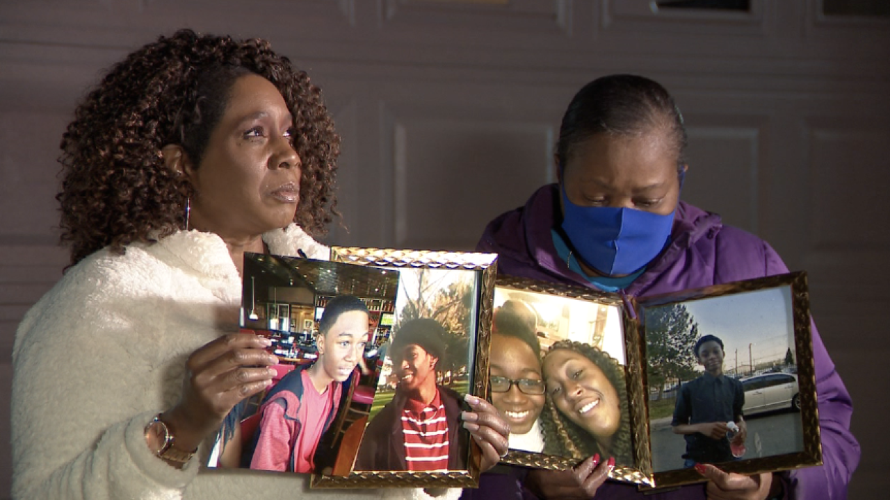 Gigi Buentipo holding pictures of La'zic Abraham who died on January 26th