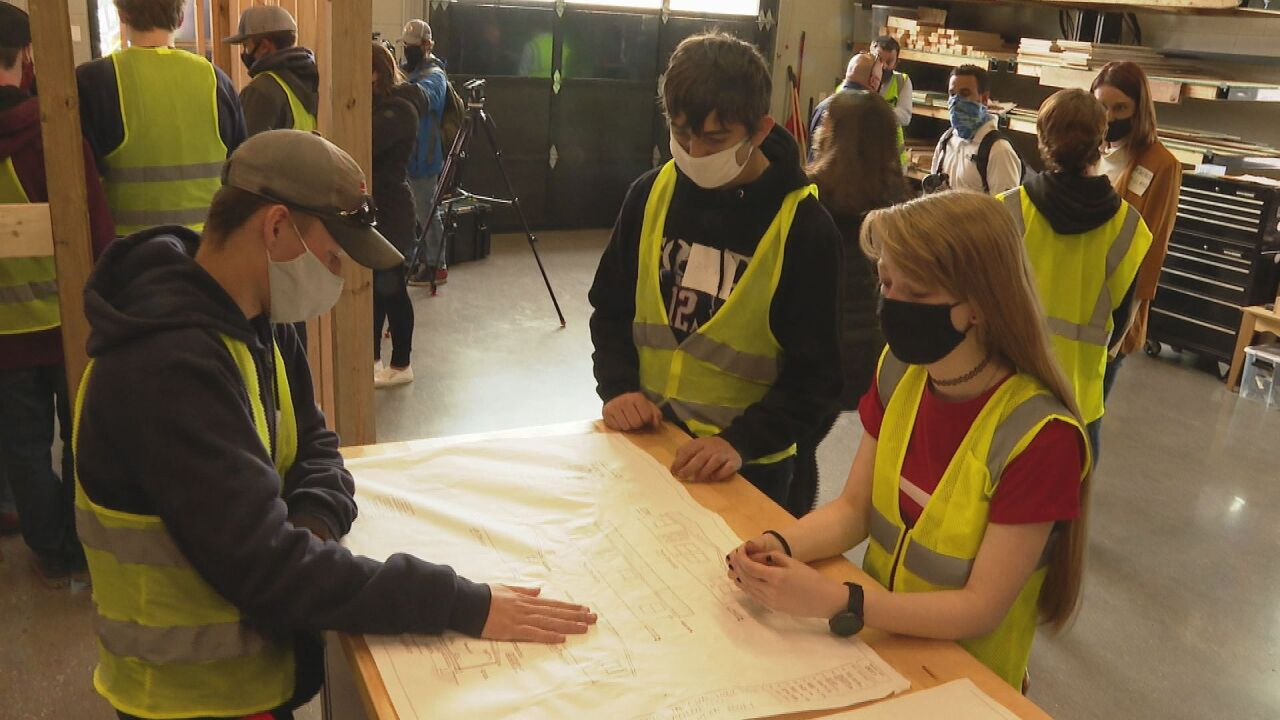 Local high school students constructing house as part of new class