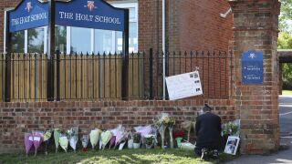 Town in England mourns victims of Saturday stabbing, which is being investigated as a terror attack