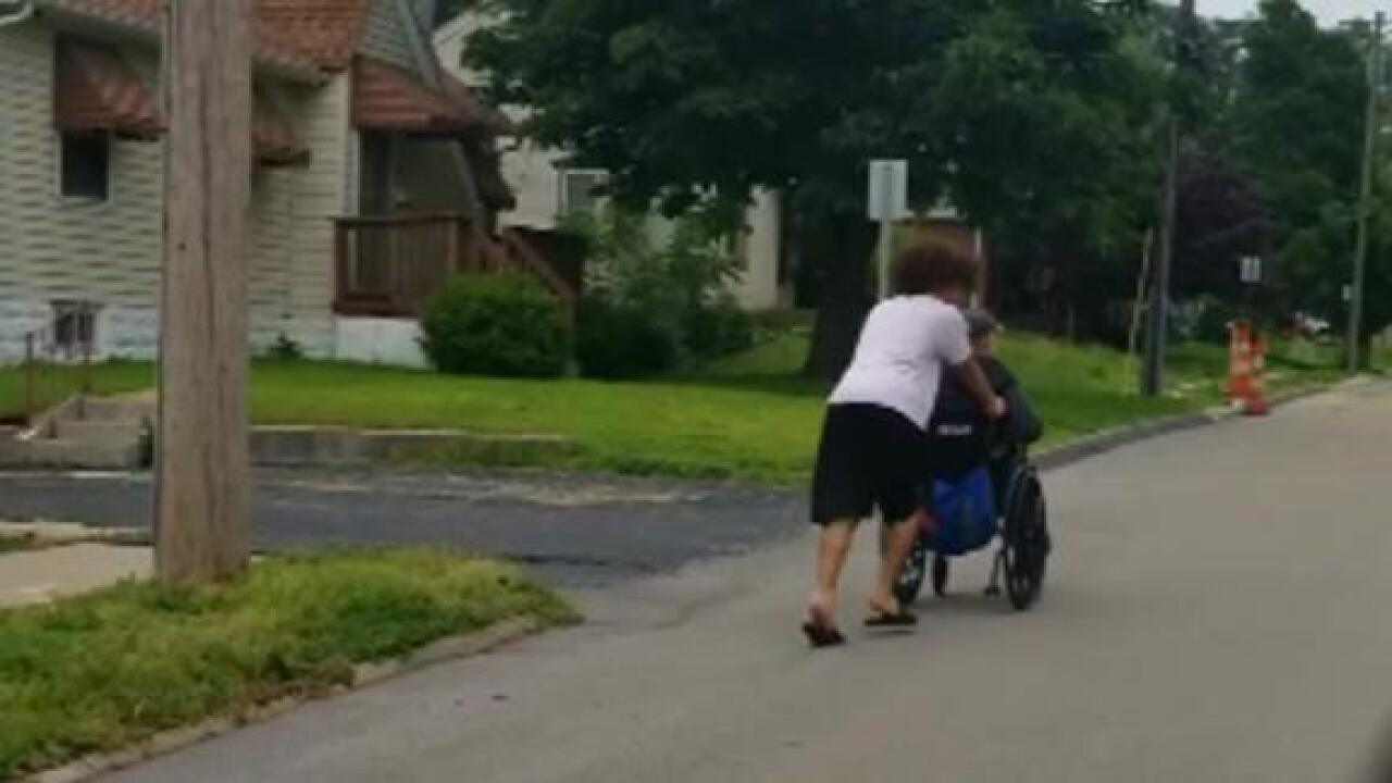 Teen stops to push man in wheelchair home during storm after being honked at by drivers