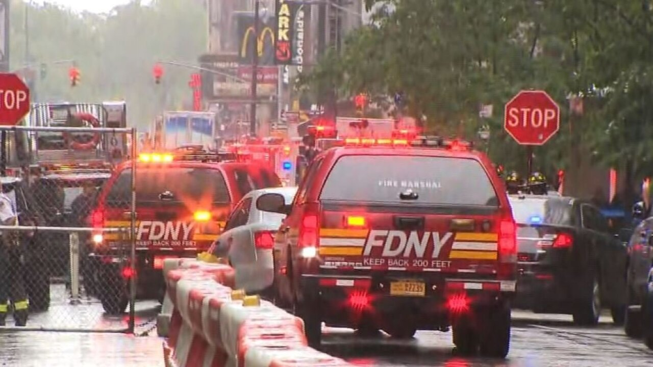 Helicopter crashes into building in New York