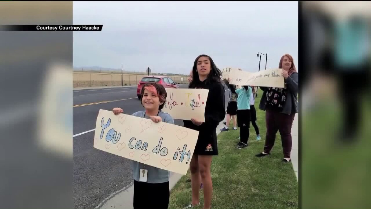 Herriman elementary students make inspiring signs as community mourns teens who died bysuicide