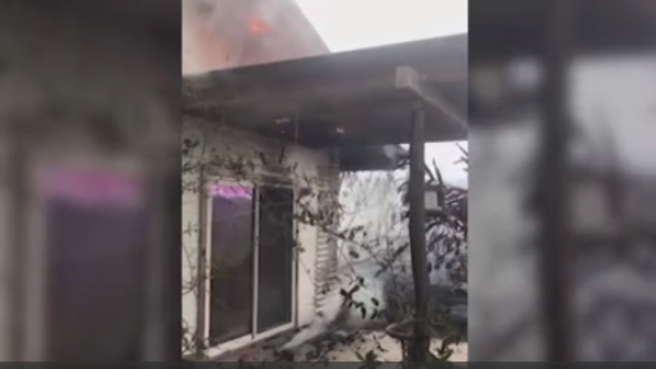 Local deputy vacationing in Hawaii jumps into action to check burning house