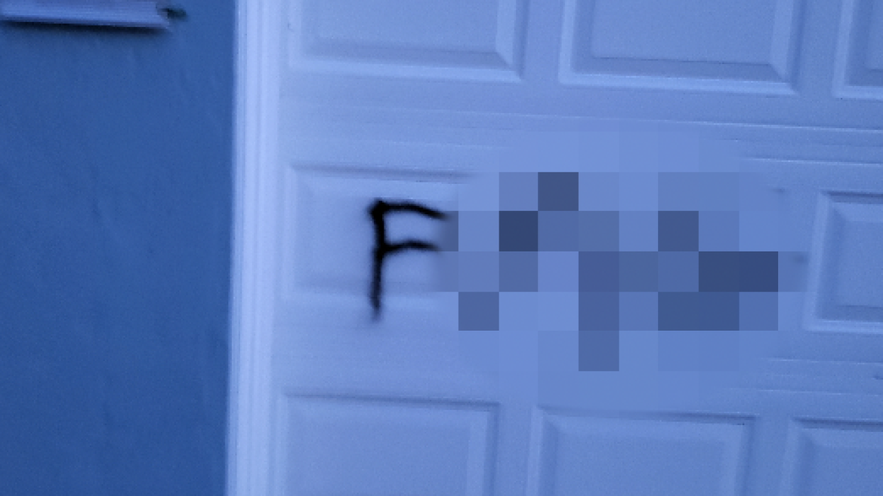 Condo owner finds gay slur spray-painted on home