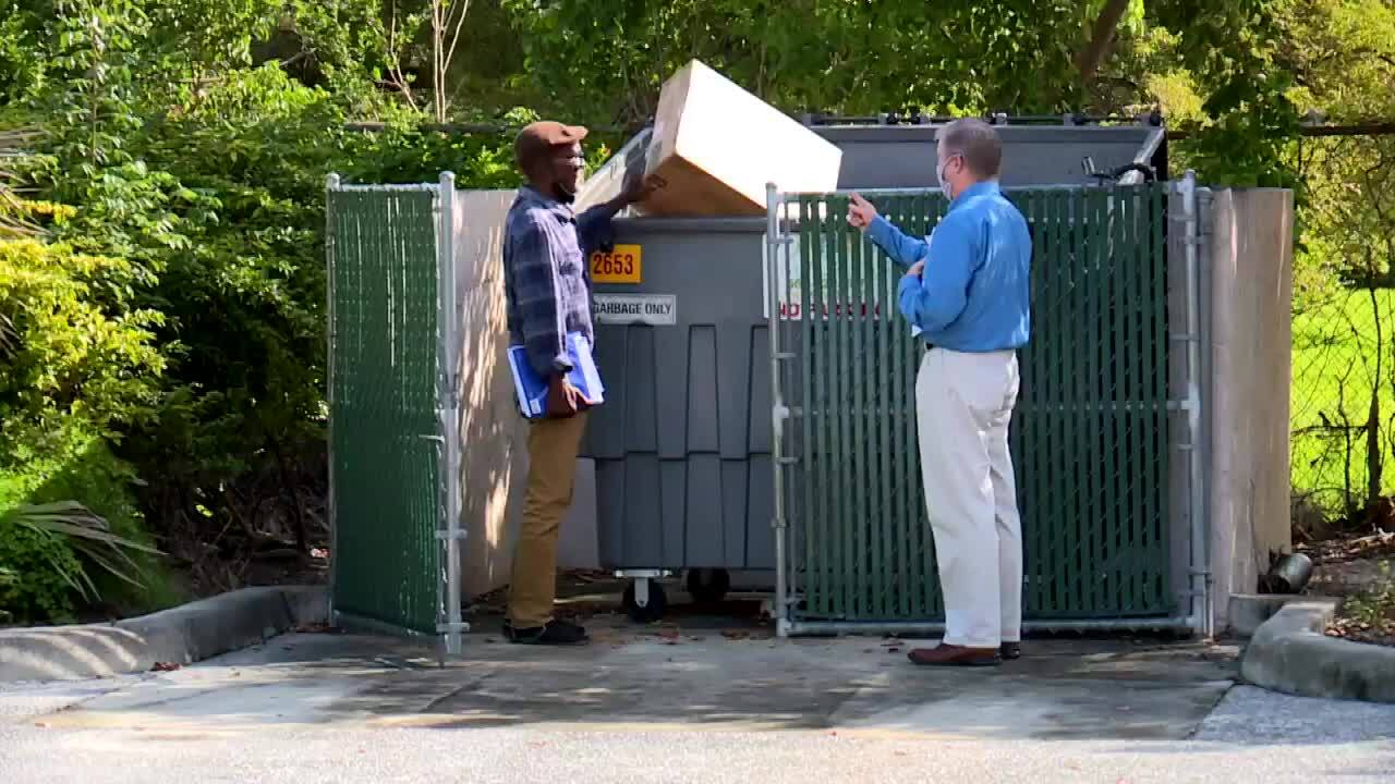 Robert Adams shows Dave Bohman how he likes to sleep in dumpster