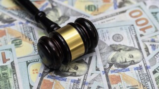 Money and hammer,Wooden gavel and dollar banknotes