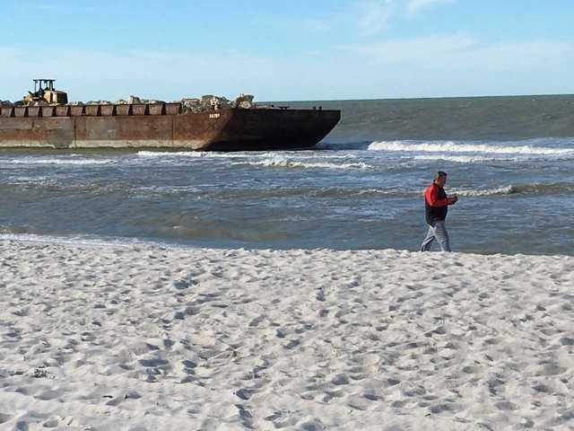 Photos: Barges run aground on Naples beach