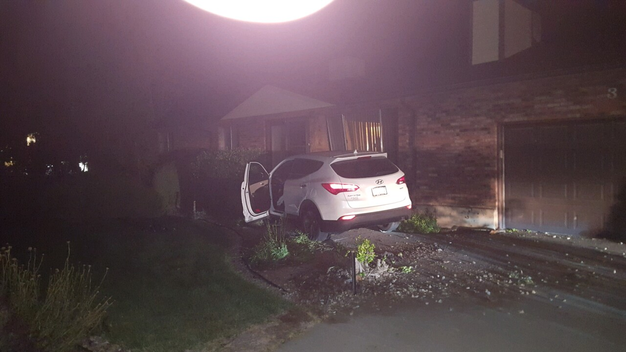 SUV smashes into side of home in Roy