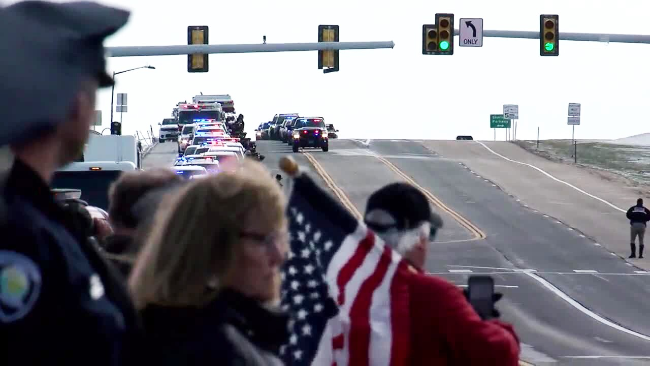 Eric Talley procession_crowd in foreground