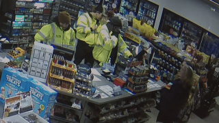 Surveillance Image Lowell Twp Gas Station Firefigthers