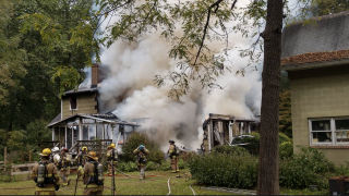Woman trapped in Crownsville house fire