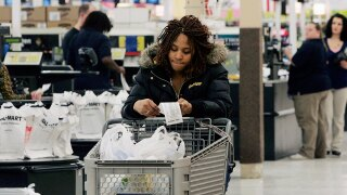 shopper-looks-at-her-receipt-AP.jpg
